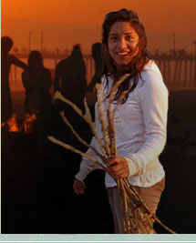 girl with sticks for bonfire